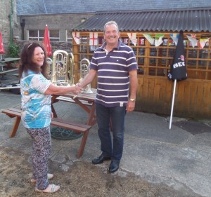 Shelagh receives instruments from Fred Little of Longridge Band